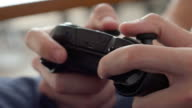 Close up of boy hands using game controller, in the end throwing the controller, angry close up video