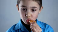 Close up of Boy is eating orange tangerines. video
