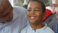 Close Up Of Boy With Grandfather And Father At Christmas video