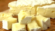 Close up of brie cheese cubes on wooden board video