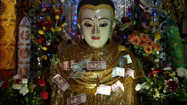 Close Up of Buddha Statue with Colorful Blinking Lights, Seamlessly Loopable video