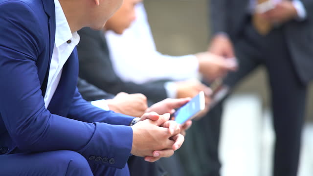 Close up of businessman using smartphone during break time.Business concept. video
