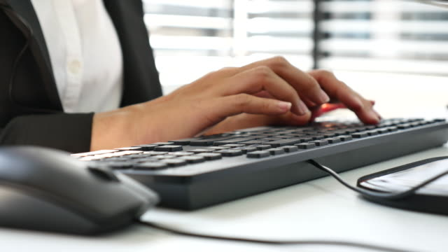 Close up of businesswoman hand typing on Computer keyboard video