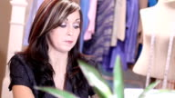 Close up of businesswoman in design shop video