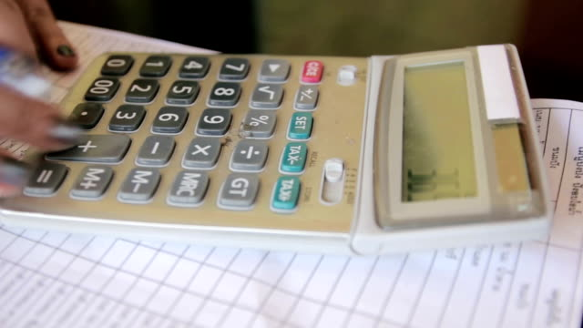 Close up of Businesswoman working on calculator,Dolly Shot video