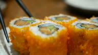 Close up of California roll Sushi Japanese food eating, 4K(UHD) video
