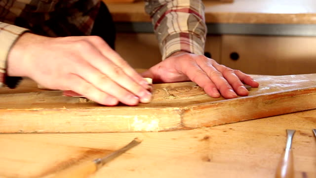 Close up of carpenter sanding wood video