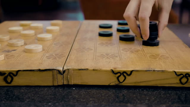Close up of checkers on checkerboard on the table video