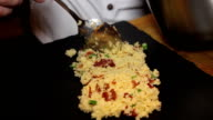 close up of chef puts Couscous to board food video