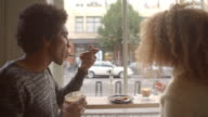 Close Up Of Couple Enjoying Coffee And Cake In Cafe video