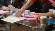 Close Up Of Designers Meeting Around Table In Modern Office video
