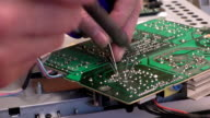 Close up of electronic circuit board soldering video