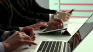 Close up of employees' hands using technology video