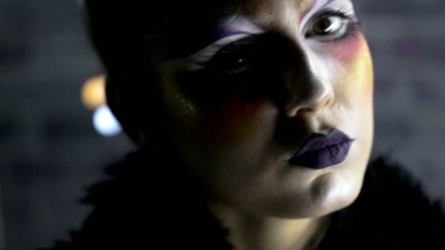 Close up of face with multicolored make-up video