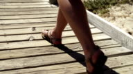 Close up of feet on pier video