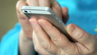 Close up of female hands holding the mobile phone video