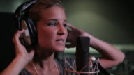 Close up of female singing in recording studio video
