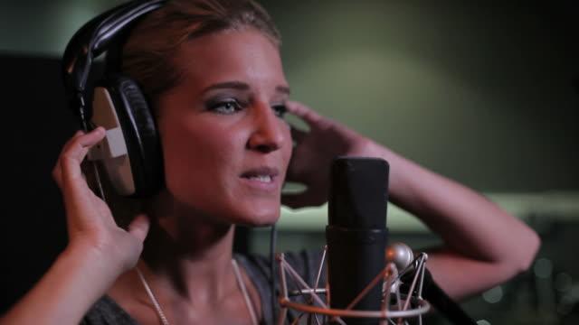Close up of female singing in recording studio video
