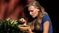 close up of female smiling eat fresh garden blackberries video