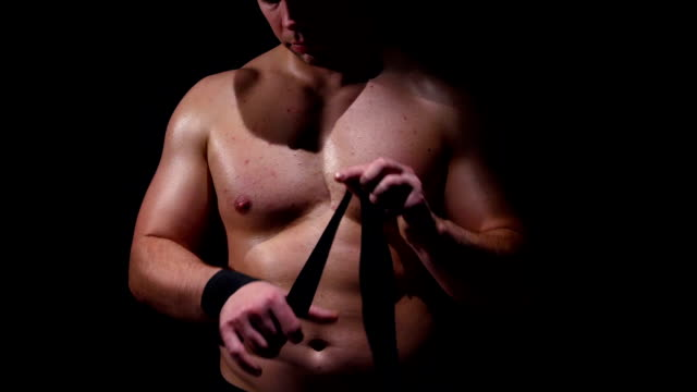 Close up of fighteris applying bondage tape on hands video