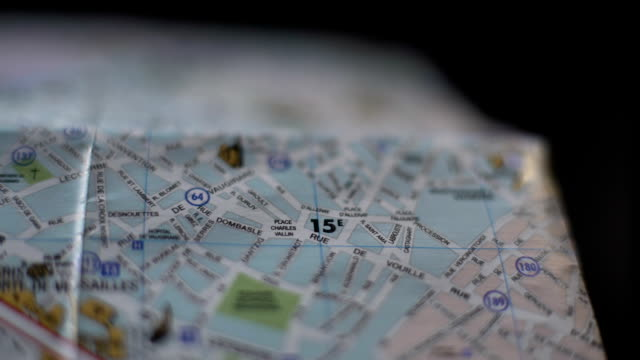 Close up of French city map, hand of tourist marking trip destination with pin video