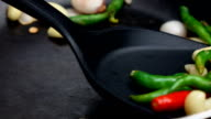 Close up of garlic and peppers being gently fried in a pan video