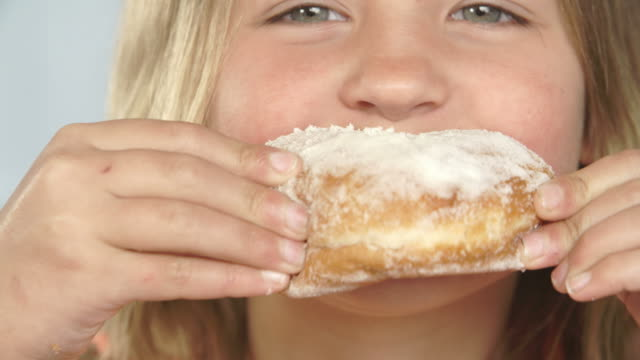 Close Up Of Girl Eating Sugary Donut video