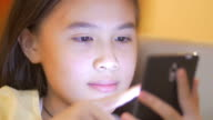 Close up of girl using smart phone video