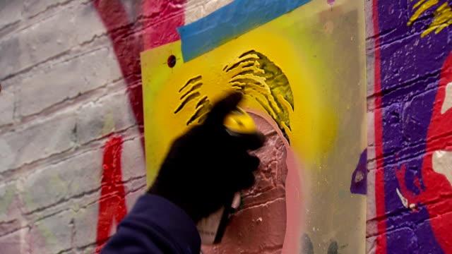 Close Up of Graffiti Artist Spraying Stencil video
