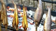 SLO MO Close up of grilled fish skewers video