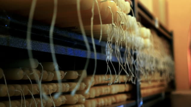 Close up of hand made candles in a factory with long wicks stored in a warehouse video
