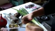 Close up of hand peeling potato video