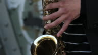 close up of hands: playing saxophone video