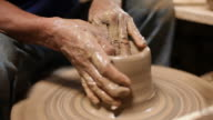 Close up of Hands working on pottery wheel, shaping a clay pot.Thailand video