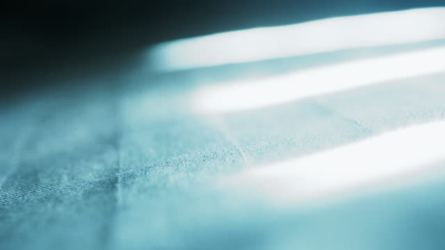 Close up of light swaying on bed video