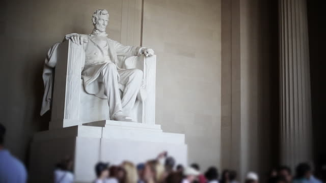 Close up of Lincoln memorial with tourists video