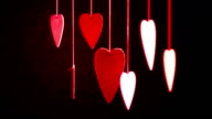 Close up of line of red hearts on ribbon. Valentines day video