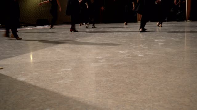 Close up of lined-up female dancing feet on stage. video