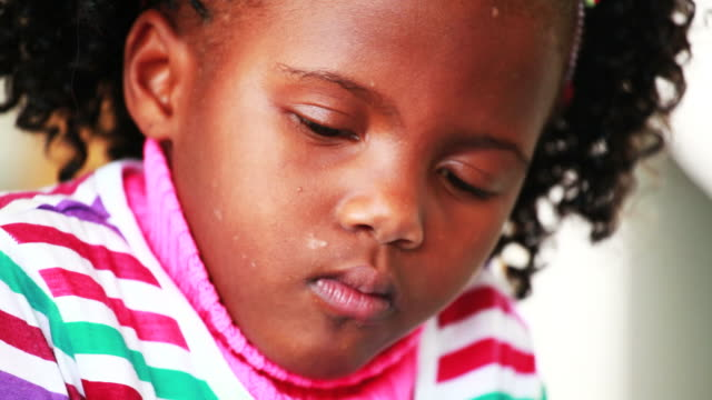 Close up of little girls face as she draws video