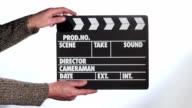 Close up of male hand holding movie clapperboard video