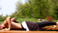 Close up of man doing push ups on bench video