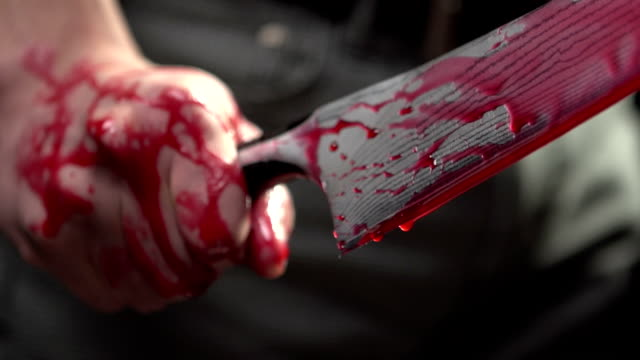 Close up of man gripping bloody knife video