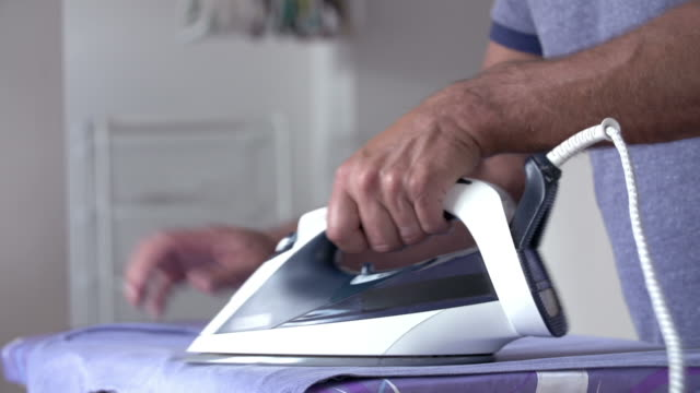 Close Up Of Man Ironing Laundry video