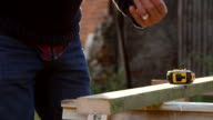 Close Up Of Man Measuring And Sawing Wood In Slow Motion video