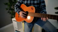 Close Up Of Man Playing Acoustic Guitar in office on break video