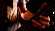 Close up of man playing bass video