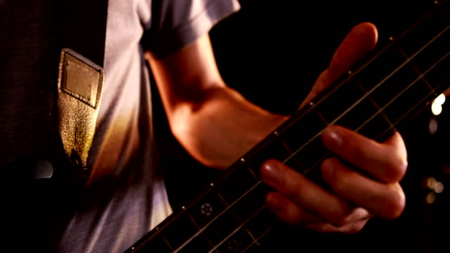 Close up of man playing bass video