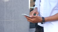 Close Up of Man Walking and Using on Phone, Outdoor Side View video