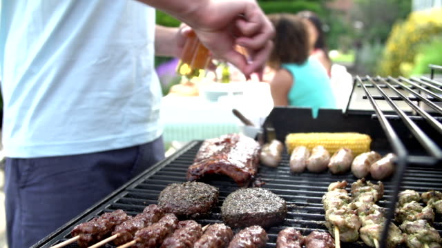 Close Up Of Of Man Cooking On Barbeque At Home video