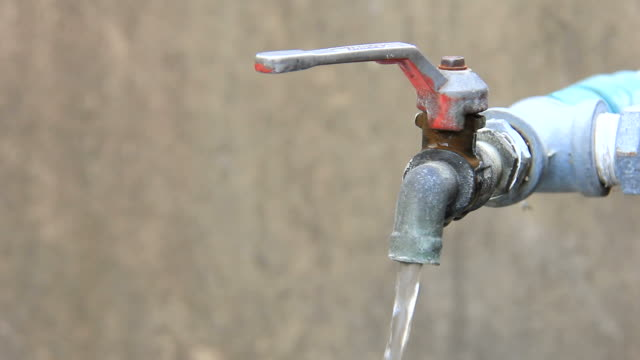 Close Up of outdoor tap on and off video